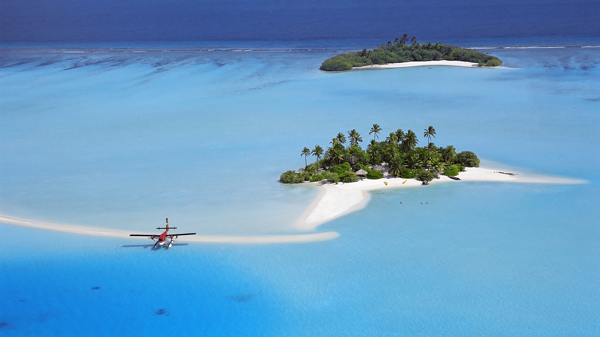 Earth - Island  - Maldives - Ocean - Paradise - Water - Aircraft - Airplane - Vacation Wallpaper