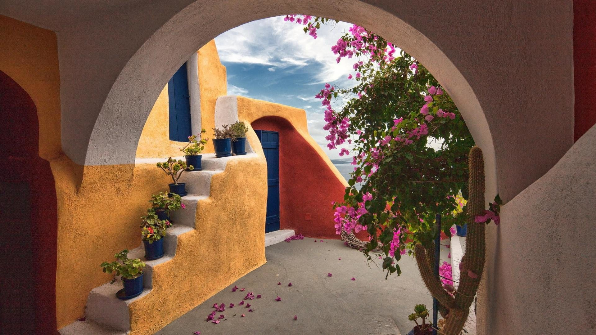 archway to house in santorini hd wallpaper background